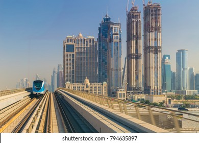 Dubai metro along the skyscrapers in United Arab Emirates