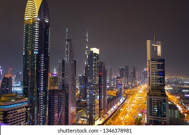 Dubai night cityscape with highway and ligths. United Arab Emirates