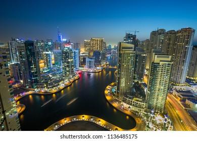 Dubai night skyline. Dubai Marina skyscrapers. Modern cityscape. Futuristic city. Luxury Dubai life.  Modern city views. Residential and office towers. Tallest Dubai buildings. Marina promenade.