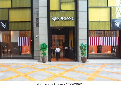 DUBAI – November 12, 2018: Businessman entering in Nespresso store. Nespresso is the brand name of Nestlé Nespresso S.A., an operating unit of the Nestlé Group, based in Lausanne, Switzerland.