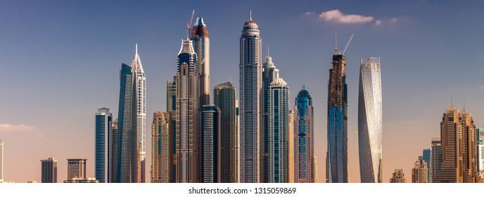 DUBAI - NOVEMBER 22, 2015: Dubai Marina skyscrapers on a sunny day. The city attracts millions of visitors worldwide every year.