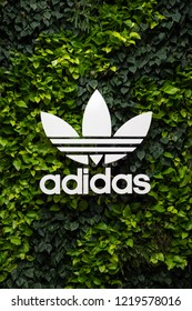 DUBAI - OCTOBER, 2018: Adidas logo. Adidas Is a German multinational corporation that designs and manufactures sports clothing and accessories.