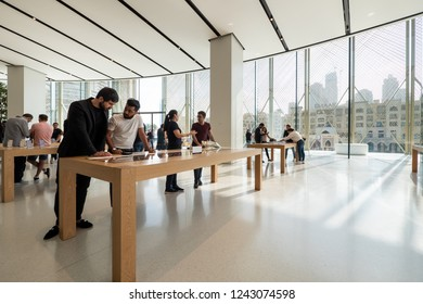 DUBAI - OCTOBER, 2018: Customer looking at new products inside Apple Store.