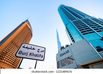 DUBAI - OCTOBER, 2018: EMAAR symbol at the entrance of The Mall with Burj Khalifa in the background. Emaar Properties is a real estate development company located in the United Arab Emirates.