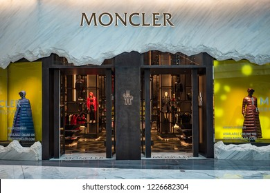 DUBAI - OCTOBER, 2018: Exterior view of Moncler fashion store inside Dubai Mall. Moncler is an Italian apparel manufacturer and lifestyle brand founded in 1952.