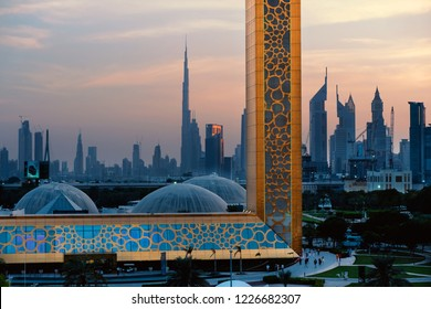 DUBAI - OCTOBER, 2018: Dubai Frame view at sunset with downtown cityscape in the background. The Frame is an architectural landmark in Zabeel Park.