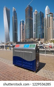 DUBAI - OCTOBER, 2018: Recycling station with skyline panoramic view of Dubai Marina in the background.
