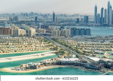 Dubai Palm Jumeirah and cityscape from helicopter.