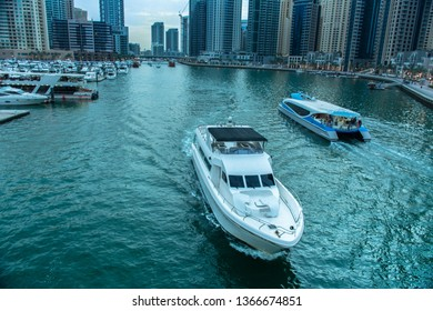 Dubai RTA boat and luxury yacht ride at marina lake, best place to enjoy holidays in middle east, modern architecture buildings