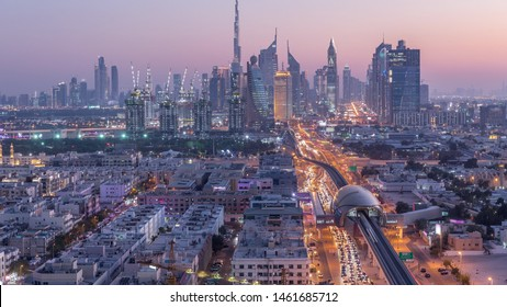 Dubai skyline after sunset with beautiful city center lights and Sheikh Zayed road traffic day to night transition timelapse. Illuminated towers and skyscrapers aerial view from zabeel district. Dubai