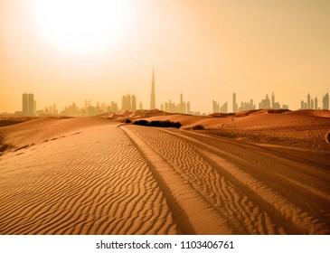 Dubai skyline in desert at sunset