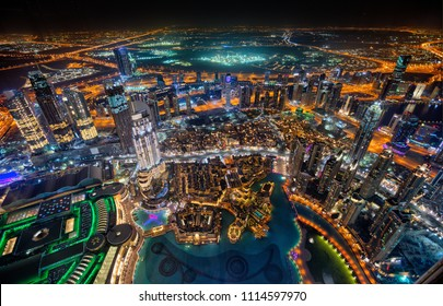 Dubai skyline during night with amazing city center lights and heavy road traffic,United Arab Emirates.
