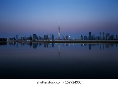 Dubai skyline at dusk seen from the Gulf Coast, shows the Sky Scrapers of the Sheikh Zayed Road