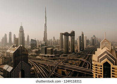 Dubai skyline in the morning, aerial top view to downtown city center landmarks at sunrise. Famous viewpoint, United Arab Emirates
