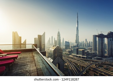Dubai skyline in the morning sunrise, panoramic aerial top view to downtown city center landmarks from famous viewpoint rooftop, United Arab Emirates