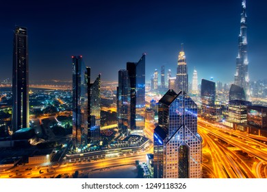 Dubai skyline at night, aerial top view to downtown city center landmarks. Famous viewpoint, United Arab Emirates