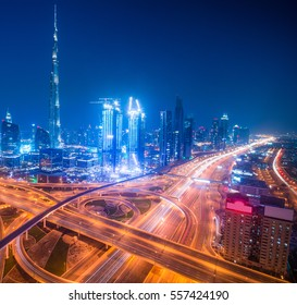 Dubai skyline at night with beautiful city with lights close to it's busiest highway