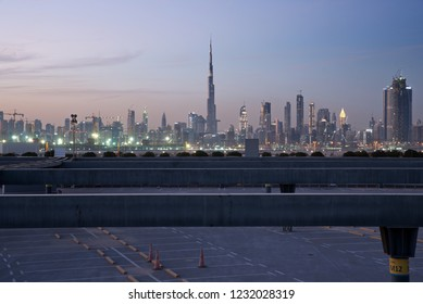 Dubai skyline at night from Meydan district, Dubai downtown and Business Bay area