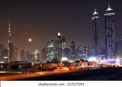 Dubai Skyline at night from new Dubai Canal, U.A.E