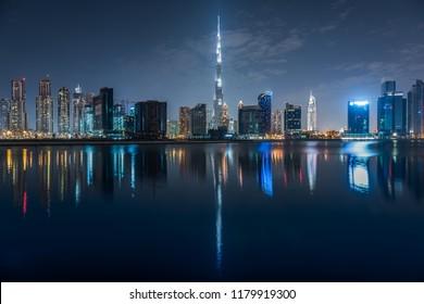 Dubai Skyline reflecting on water, Dubai, United Arab Emirates, December 2016
