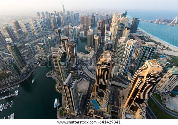 Dubai skyline, skyscrapers. Dubai Marina from above. Morning light. Dubai morning. Cayan tower view. Luxury homes, private property.