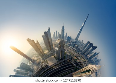 Dubai skyline at sunrise, Little Planet effect. panoramic aerial top view to downtown city landmarks. Famous viewpoint, United Arab Emirates