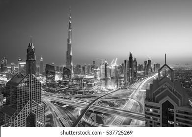 Dubai skyline at sunset with beautiful city center lights and Sheikh Zayed road traffic,Dubai,United Arab Emirates