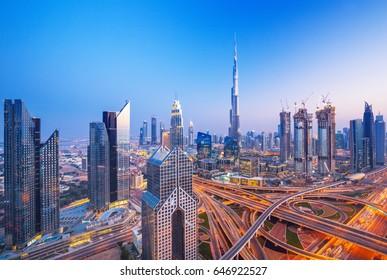 Dubai skyline at sunset with beautiful city center lights and Sheikh Zayed road traffic, Dubai, United Arab Emirates