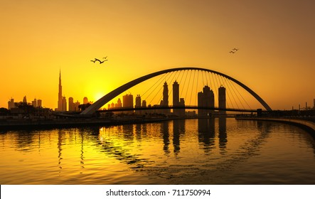 Dubai skyline thru the canal during sunrise