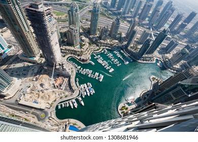 Dubai skyscrapers from above. Incredible Dubai view. Futuristic skyline. Dubai Marina aerial view. Skyscraper construction. Dubai yachts. Aerial view. Sheikh Zayed road. Iconic skyline.