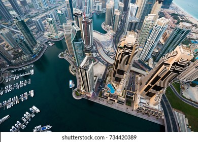 Dubai skyscrapers. Dubai Marina from above. Morning light. Futuristic skyline. Luxury homes, private property. Cayan tower view.