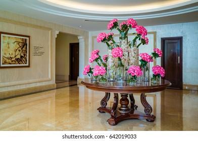 Dubai. Summer 2016. Bright and marble interior The Ritz Carlton Dubai Hotel. Bouquets of roses to the interior of the hotel. Welcome to Dubai.