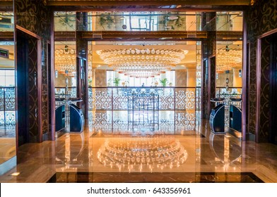 Dubai. Summer 2016. Bright and modern interior the hotel Waldorf Astoria Palm Jumairah. Designer chandelier in the interior.