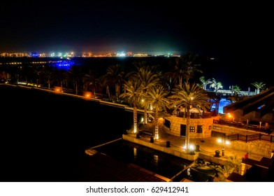 Dubai. In the summer of 2016. A water oasis in the night on the territory of Madinat Jumeirah Mina a Salam. Night lighting of the hotel.