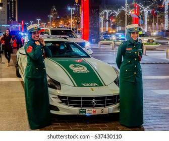 Dubai. Summer 2016. Dubai women police at the luxurious Ferrari near Dubai Mall smile. Arab woman in the modern world. Welcome Dubai.