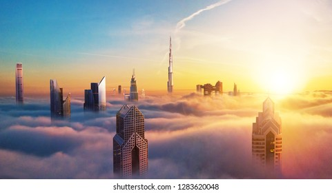 Dubai sunset panoramic view of downtown covered with clouds. Dubai is super modern city of UAE, cosmopolitan megalopolis. Very high resolution image