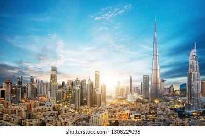 Dubai sunset panoramic view of downtown. Dubai is super modern city of UAE, cosmopolitan megalopolis.