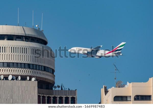 Dubai, UAE. 03/06/2020. Airbus 380-800 from the Emirates Airlines fleet fly over Dubai.
