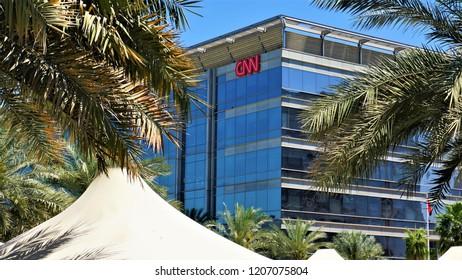 Dubai, UAE, 08.20.2018. Dubai media city, CNN office between the palm trees.