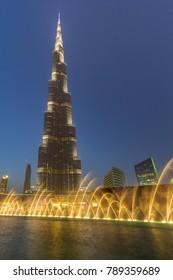 DUBAI, UAE - 1 APRIL 2014: Downtown of Dubai with Burj Khalifa building at dusk, UAE. Dubai is the most populous city in the United Arab Emirates with 2,1 million people.