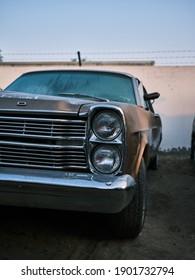DUBAI UAE - 11 22 2020: abandoned cars in dubai, dramatic sky scrap yard, vintage cars, american cars