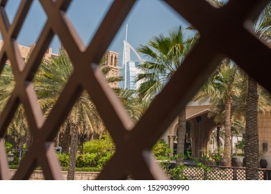DUBAI, UAE - 12 APRIL 2017: View for Burj Al Arab hotel from the Madinat Jumeirah in Dubai, UAE. Burj Al Arab with 321 meters high is the most luxurious 7 star hotel and a symbol of modern Dubai.
