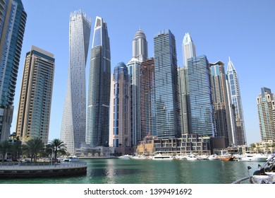 Dubai, UAE - 12 April 2019: iconic high rise skyline at Dubai Marina with famous landmarks Cayan Tower and Damac Heights, Marina Gate Towers, Emirates Crown and more