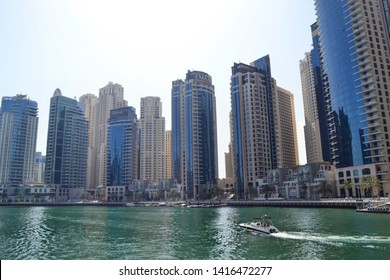 Dubai, UAE - 12 April 2019: overview Dubai Marina skyline with modern high rise skyscrapers waterfront living apartments development by Emaar