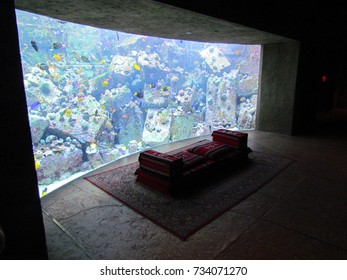 Dubai UAE, 12 August 2013: Empty arabian seating in front of a colorful aquarium full of fish in Atlantis luxury hotel on the Palm