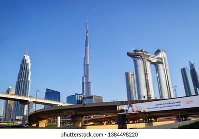 Dubai, UAE - 15 April 2019: famous Dubai skyline with Burj Khalifa and Emaar Sky view project towers