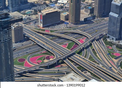 Dubai, UAE - 16 April 2019: close up at colorful cloverleaf highway from the top of Burj Khalifa in Dubai