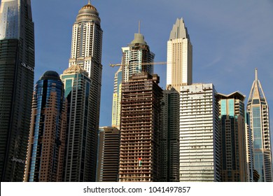 DUBAI, UAE - 16 DECEMBER 2017: Tall skyscrapers on the Dubai Marina. Dubai, the largest city in the UAE, is home to 911 completed high-rises, 88 of which stand taller than 180 metres. Editorial.