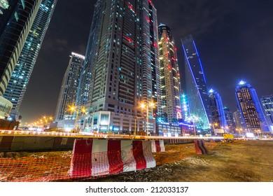 DUBAI, UAE - 2 APRIL 2014: Skyscrapers of Dubai Marina at night, UAE. Dubai Marina is a district in Dubai with artificial canal city who accommodates more than 120,000 people at Persian Gulf.