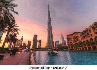 Dubai, UAE - 2018 - A view for Dubai Skyline showing Burj Khalifa and dubai opera at the cloudy dusk time.